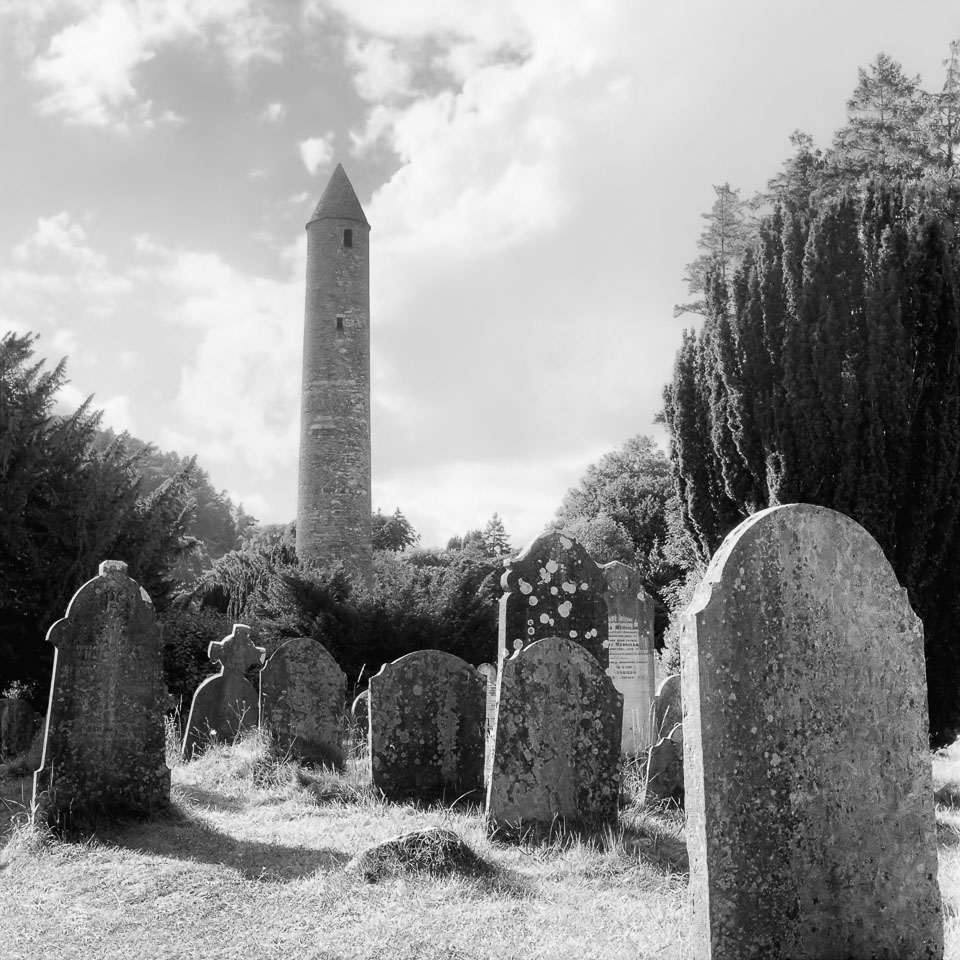 Glendalough round tower, Wicklow, Ireland black and white photo